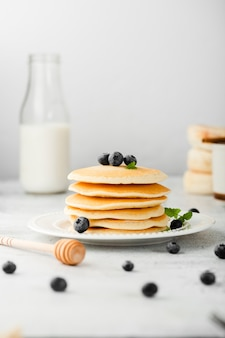 Front view collection of pancakes with blueberry