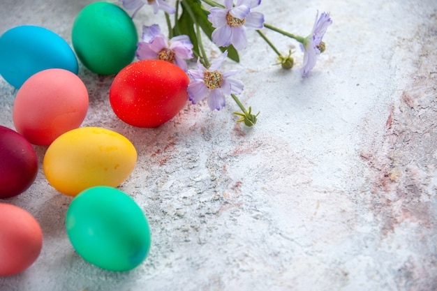Front view colored easter eggs on white surface ornate colourful group colours spring multi