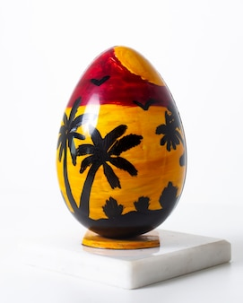 Front view colored egg yellow red beach designed on the white surface