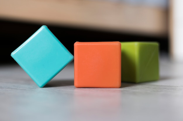Front view of colorful cubes on floor