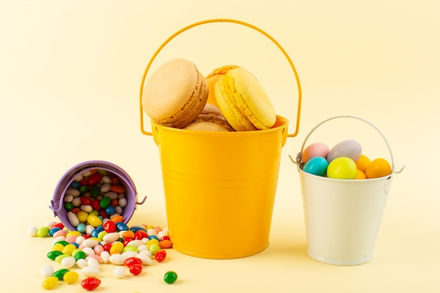 A front view colorful french macarons inside basket with candies bake