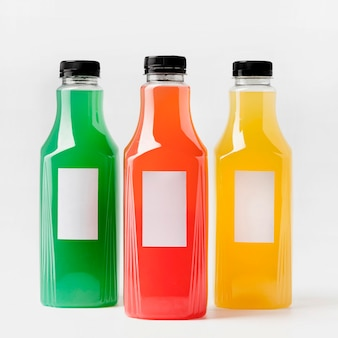 Front view of colorful juice bottles with caps