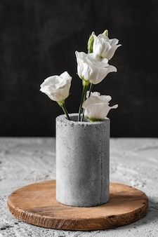 Front view composition of flowers in gray vase