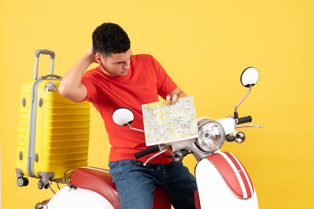 Front view confused handsome man on moped looking at map