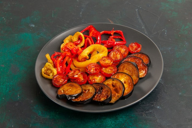 Front view cooked bell-peppers with eggplants on green surface