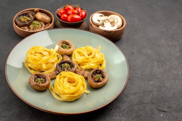 Front view cooked mushrooms with dough pasta on dark table food meal color dinner