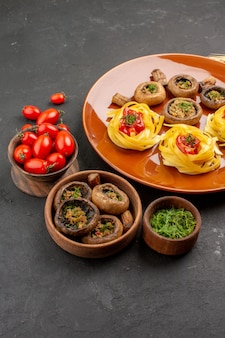 Front view cooked mushrooms with dough pasta on dark table meal dish food dinner color