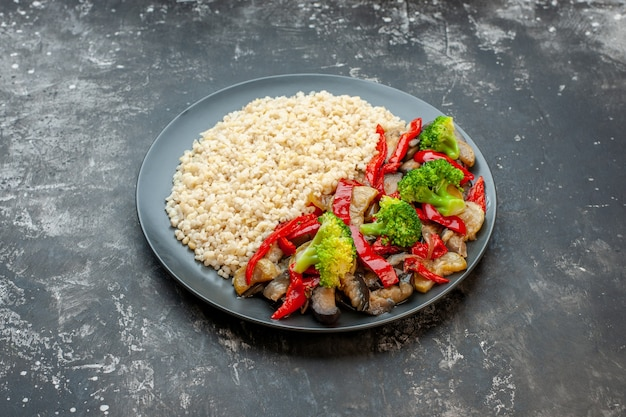Front view cooked pearl barley with cooked vegetable