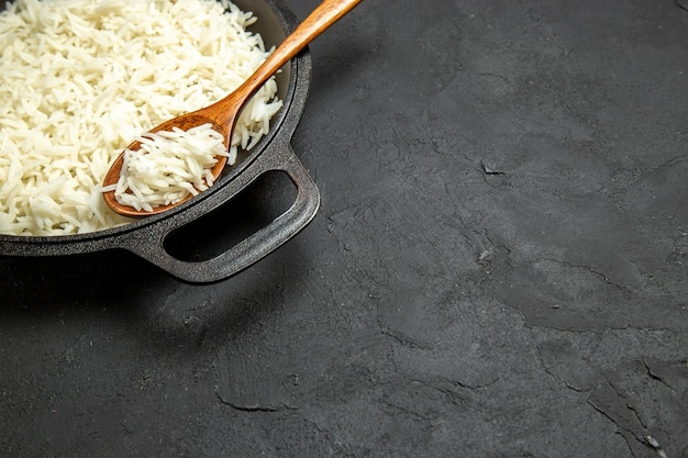 Front view cooked rice inside pan on a dark surface meal food rice eastern dinner