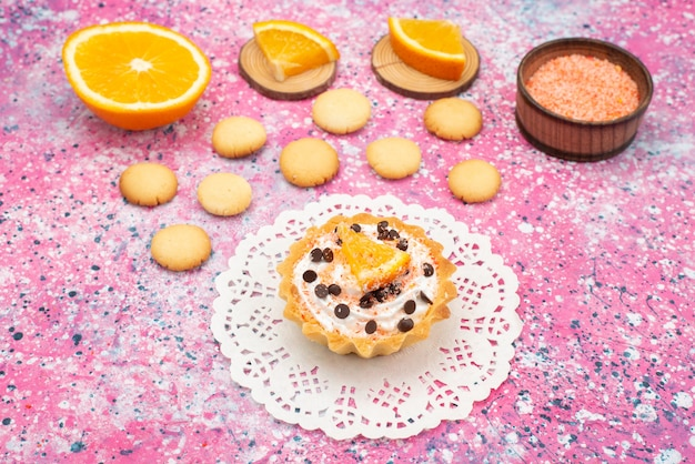 Front view cookies and cake with orange slices on the colored surface cookie biscuit fruit cake sweet