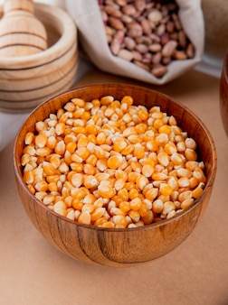 Front view corn grains in a bowl on a notebook