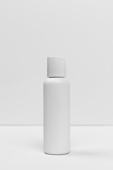 Front view of cosmetic bottle with copy space