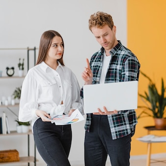 Front view of couple planning together to redecorate the house