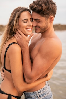 Front view of couple smiling and hugging