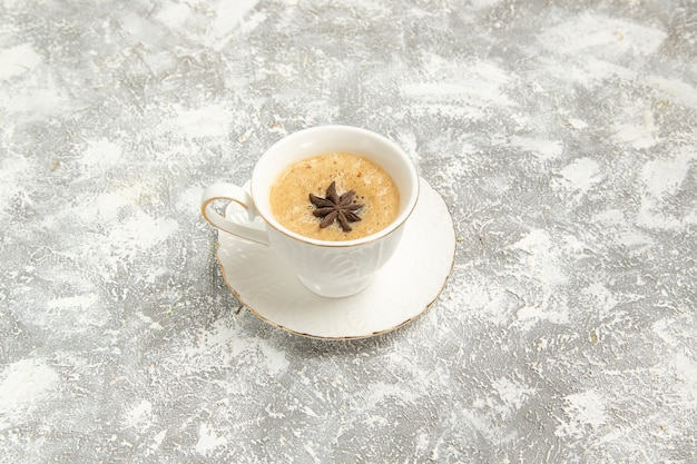 Front view cup of coffee on white surface