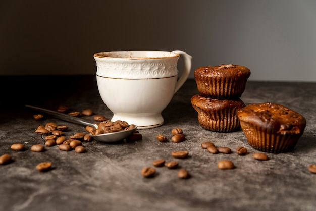 Front view cup of coffee with muffins