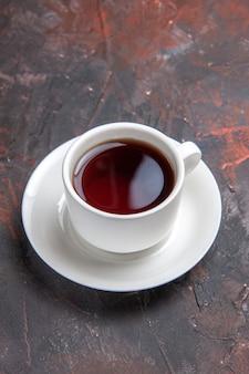 Front view cup of tea on dark table color dark ceremony tea