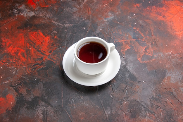 Front view cup of tea on dark table color dark tea ceremony