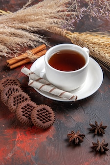 Front view cup of tea with choco cookies on dark table cookie biscuit tea