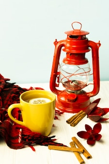 Front view cup of tea with lamp