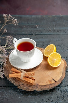 Front view cup of tea with lemon on a dark background