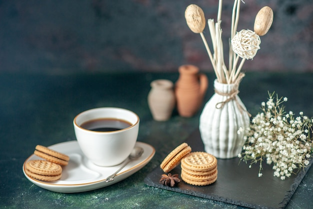 Front view cup of tea with sweet biscuits on dark surface bread drink ceremony breakfast morning glass sugar photo color cake sweet