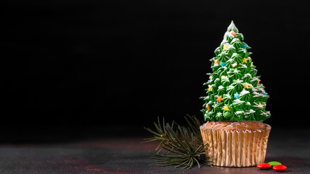 Front view of cupcake with christmas tree frosting and copy space
