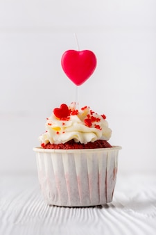 Front view of cupcake with heart-shaped sprinkles