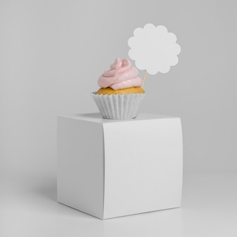 Front view of cupcake with packaging box