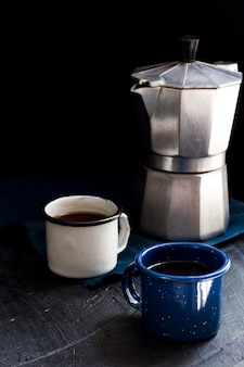 Front view cups of black coffee on table