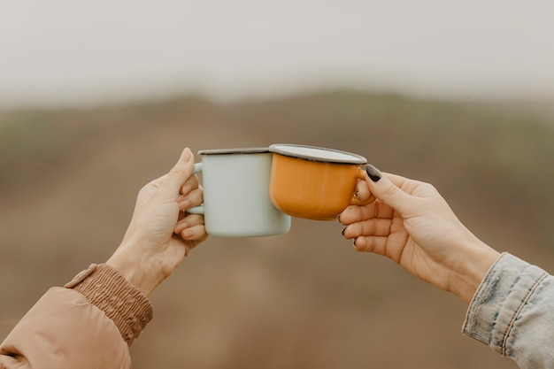 Front view cups with hot tea for breaks