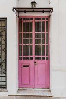 Front view of cute building door in the city