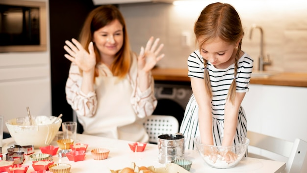 Front view of cute family cooking together