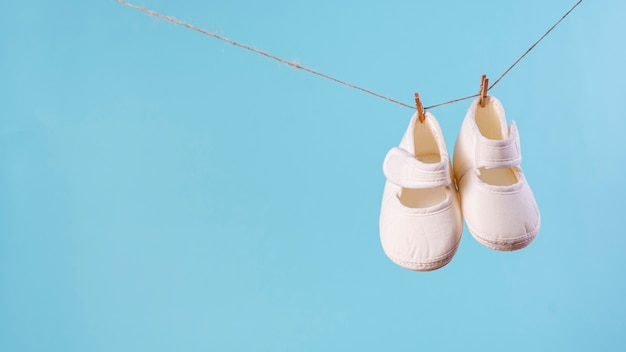 Front view of cute little baby shoes with copy space