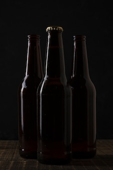 Front view dark colored bottles of beer