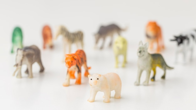 Front view of defocused animal figurines for animal day