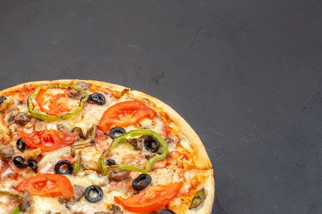Front view delicious cheese pizza consists of olives pepper and tomatoes on dark surface
