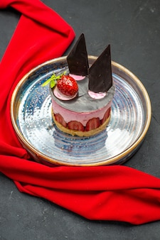 Front view delicious cheesecake with strawberry and chocolate on plate bowls