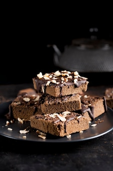 Front view of delicious chocolate cake with almonds