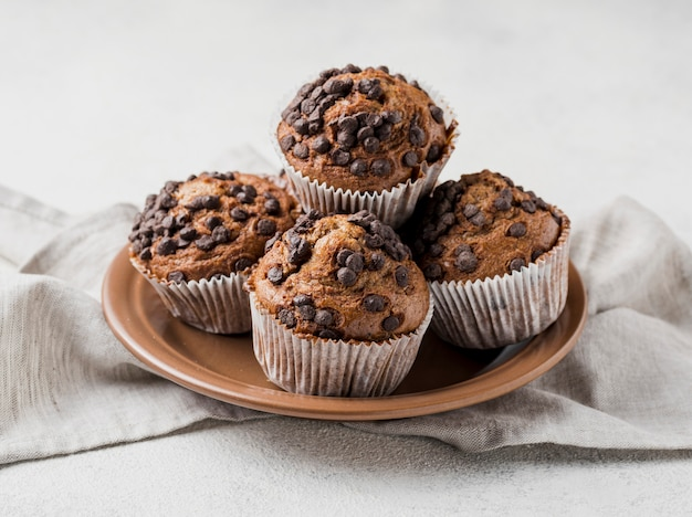 Front view delicious chocolate chips muffins on plate