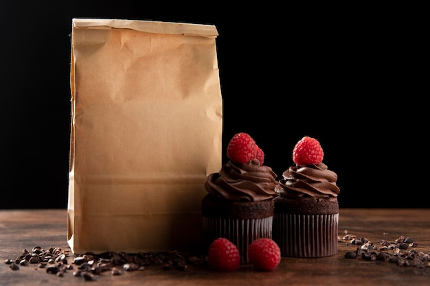 Front view of delicious chocolate cupcakes with raspberry