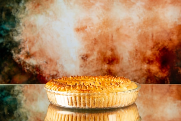Front view delicious fruit pie on light brown background biscuit sweet bake oven color cookie sugar cake