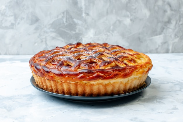 Front view delicious fruity pie with jelly on a light background biscuit cookie bake nut pie cake dessert color tea
