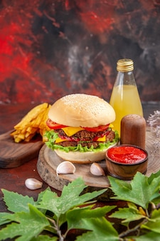Front view delicious meat burger with french fries on dark background