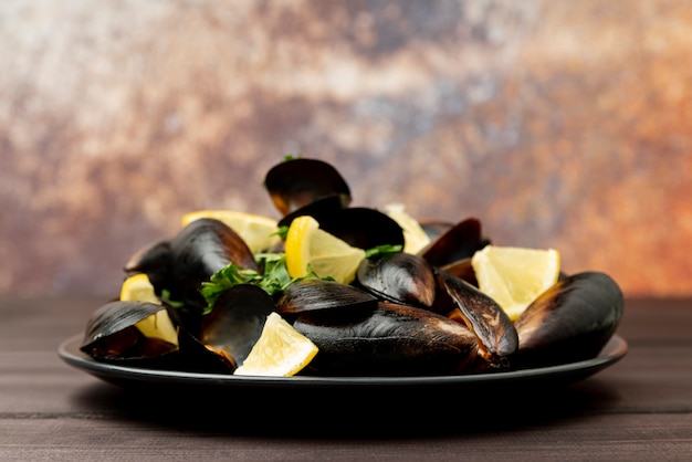 Front view delicious mussels with lemon