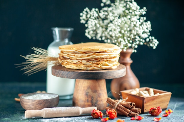 Front view delicious pancakes with milk on dark blue dessert breakfast honey cake milk sweet morning pie