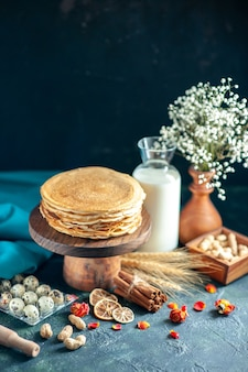 Front view delicious pancakes with milk on a dark breakfast honey cake pie morning tea dessert milk sweet