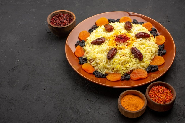 Front view delicious plov with different raisins on dark space