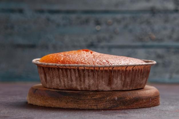 Front view delicious round pie sweet bake on dark background cake biscuit sweet pie sugar tea dough