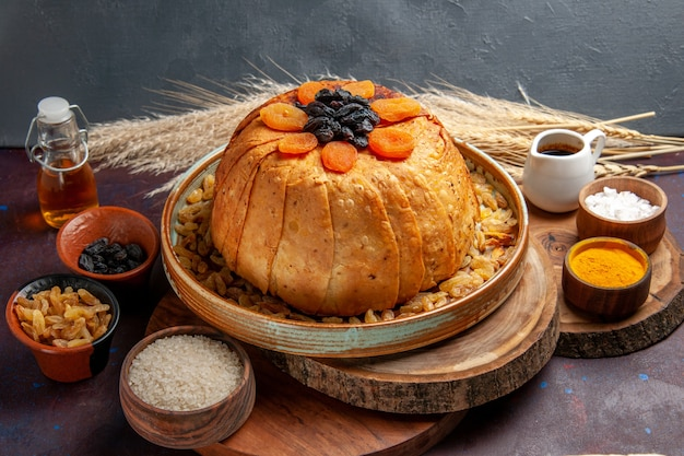 Front view delicious shakh plov cooked rice meal with raisins on a dark background meal food dough cooking rice dinner
